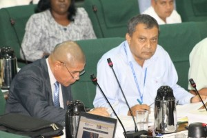 FLASH BACK: The Chief Executive Officer of the Georgetown Public Hospital Corporation, Michael Khan (right) assisting Public Health Minister Dr. George Norton in responding to questions by the opposition during the National Assembly's consideration of the 2015 Budget Estimates.