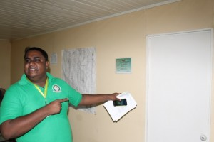 Aseef Balmacoon outside the Board Room of the Hope Coconut Industries Limited. He was prevented from entering the room by Board Chairman. Iamaei Aowmathi who was inside with a ranger armed with a shotgun.
