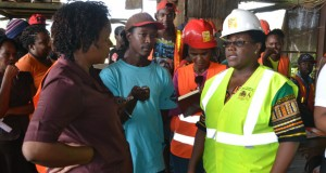 FLASH BACK: Minister within the Ministry of Social Protection, Simona Broomes, addressing GAWU representative Angela Henry in the presence of concerned DTL workers. (Guyana Chronicle photo)