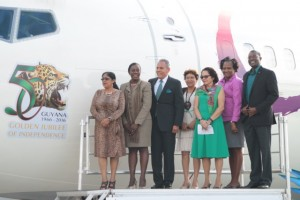 Wife of Prime Minister Moses Nagamootoo, Mrs. Sita Nagamootoo; Minister within the Ministry of Education, Ms. Nicolette Henry, Caribbean Airlines Chairman, Mr. Phillip Marshall, Minster within the Ministry of Indigenous People's Affairs, Ms. Valerie Garrido-Lowe, First Lady, Mrs. Sandra Granger, Minister within the Ministry of Public Infrastructure, Ms. Annette Ferguson and Minister of Public Infrastructure, Mr. David Patterson at the unveiling of Guyana's jubilee anniversary logo on one of Caribbean Airlines' jets.