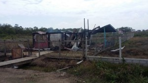The remains of the house at Hope, West Coast Berbice where a woman was burned to death and her son injured by bandits.