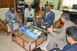 Minister of State, Mr. Joseph Harmon, (centre) in discussions with Canadian Hall of Fame footballer, Mr. Alex Bunbury, while New York-based coach Mr. Stanley Harmon, (left of Minister Harmon) and, from right; Productivity Coach, Ms. Alicia Nichols and Finance Consultant for the project Mr. Les Logston look on. (GINA photo).