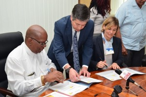 Minister of Finance ,Winston Jordan and Sophie Sirtaine, World Bank Country Director, Caribbean Country Management Unit Latin America and the Caribbean Region sign the US$3M agreement for the rehabilitation of the Cunha Canal