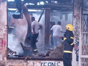 FLASH BACK: Fire fighters searching the rubble for the remains of the two teenage sisters who perished in the blaze.