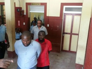 Jason Abdulla (front). Kwame Mc Coy (red shirt) and Shawn Hinds) in the Georgetown Magistrates' Court yard.