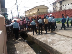 Officers holding back crowds that had gathered at the Prison