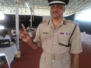 Police Commissioner Seelall Persaud displaying his ink stained finger