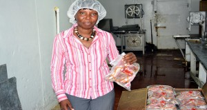 Allison Butters-Grant holds a parcel of processed fish which her company produces for local and overseas markets. (Guyana Chronicle photo)