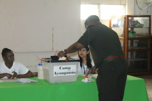 Chief of Staff of the Guyana Defence Force, Brigadier Mark Phillips casting his ballot at Base Camp Ayanganna. The green table cloth can be seen.