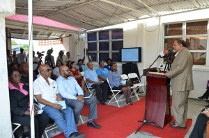 Prime Minister Moses Nagamootoo addressing the audience at the commissioning of the Satellite Earth Station Multimedia Teleport at NCN