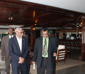 President David Granger and Minister of Public Security, Khemraj Ramjattan. In the background is Minister of State, Joseph Harmon.