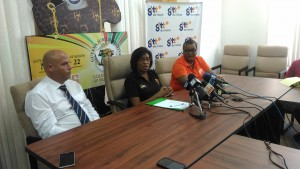 Telecommunications Minister Kathy Hughes flanked by GTT Officials