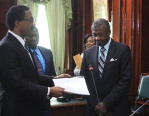 The report being handed over to House Speaker Dr Barton Scotland