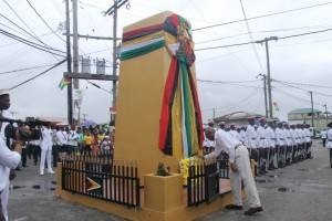 President David Granger laying a wreath at the Cenotaph in Bartica during the declaration of that district as a town.