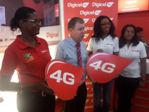 CEO of Digicel (Guyana), Kevin Kelly (centre); Head of Marketing, Jacqueline James and Communications Manager Vidya Bijlall-Sanichara.