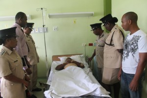 "Assistant Commissioner ""Administration"" Mr. David Ramnarine, DSM, and other senior officers of the Guyana Police Force visited the injured Police Lance Corporal, Andrew Richardson at the hospital, where they offered him words of comfort and encouragement.   Lance Corporal Andrew Richardson was shot and injured in an armed confrontation during a robbery at the Princess Hotel early Friday morning."