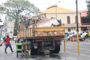 A truck carrying away demolished stalls.