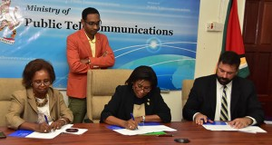 "An Information Communication Technology (ICT) needs assessment project will get underway in hinterland and rural communities in Guyana, following a US$524,00o contract which was signed among the Government of Guyana, Germany-based Detecon Consultancy and the United Nations Development Programme (UNDP). Present at the signing today, was Resident UNDP Coordinator, Khadija Musa who co-signed the agreement alongside Minister of Public Telecommunications, Catherine Hughes and Stephan Dieter, Detecon International representative. Titled ""ICT Access and e-Services for Hinterland, Poor and Remote Communities"", the project is a starting point ICT study to find out among other things, what infrastructure, technical capacity, and legal framework are already there in poor, remote and un-served areas in Guyana. During brief remarks Minister Hughes pointed out that for many years Guyana has been lagging behind the rest of the developing world because of the lack of technological resources to meet the demands and standards in almost every field of endeavour, for every service and product. Minister Hughes said that the needs assessment project is a very important one, which allows Government to start an evaluation of the country's ICT needs. The project will be out for funding to the Guyana Redd+ Investment Fund (GRIF). (Guyana Chronicle photo)"