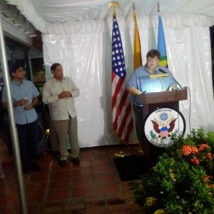 US Charge D'Affaires, Bryan Hunt delivering a stinging farewell speech. At left are Prime Minister Moses Nagamootoo and Mr. Hunt's partner, Haroon.
