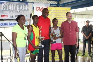 CARICOM 10 k winners Cleveland Forde from Guyana and Linda McDonalnd from St. Vincent and the Grenadines pose for a photo with Minister in the Ministry of Sports, Guyana, Hon. Nicolette Henry. CARICOM Chairman and Prime Minister of Dominica Hon. Roosevelt Skerritt and Secretary General of CARICOM Ambassador Irwin LaRocque after the twelfth staging of the event on Sunday July 3, 2016.