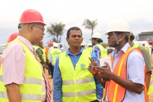 Shadow Public Infrastructure Minister, Juan Edghill (left) speaking with Chief Executive Officer of the Cheddi Jagan International Airport, Ramesh Ghir and Ministry of Public Infrastructure's Project Manager, Carmichael Thorne during a tour of runway extension works.