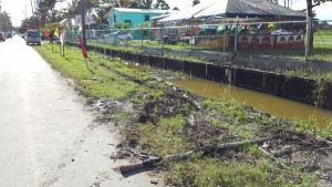 The northern drain on Woolford Avenue where the car struck down three St.Lucian cub scouts. One was seriously injured.