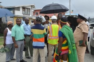 (Centre) Junior Minister of Public Infrastructure, Annette Ferguson listening to the concerns of Sophia residents