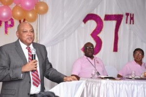 Minister of Natural Resources, Raphael Trotman addressing staff of GGMC at their anniversary celebrations. At the head table are GGMC's Acting Commissioner Newell Dennison and Chairman Stanley Ming (GINA photo)