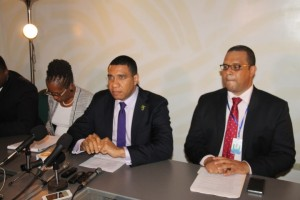 Jamaica's Prime Minister, Andrew Holness (centre) briefing reporters about the outcome of the Caricom Summit that was held in Guyana from July 4 to 6, 2016.