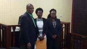 (Centre) Retired Colonel WIndee Algernon flanked by Minister of State, Joseph Harmon and City Magistrate, Fabayo Azore.
