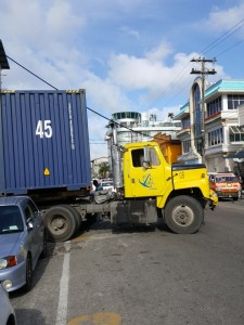 A shipping container that was recently being maneuvered in the heart of commercial Georgetown.