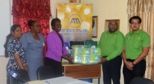 Ansa McAl representatives hand over diapers to Ministry of Education representatives. From left to right; Head of School Health, Nutrition and HIV/AIDS unit Janelle Sweatnam, Deputy Chief Education Officer, Donna Chapman, Permanent Secretary of the Ministry of Education, Delma Nedd along with Ansa Mcal representatives.