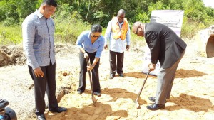 Head of Jag's Aviation, Alana Tiwari and Minister of State, Joseph Harmon turning the sod for the construction of a hangar at the Eugene F. Correia International Airport. At left is Mr. Brian Tiwari.