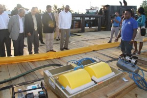 GAICO's CEO, Komak Singh (second from right) explains how the oil spill clean up mechanism works aboard the MS Maleka. Others in picture from left are Professor Suresh Narine, Chairman of the Private Sector Commission Eddi Boyer and Health Minister Dr. George Norton.