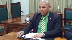 Public Health Minister, Dr. George Norton addressing a news conference on the controversial pharmaceutical bond.