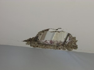 A gaping hole along the second floor corridor of the Kato Secondary School
