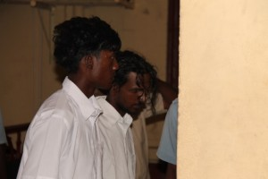 Jairam Tajeram and Tameshwar Jagmohan at the Georgetown Magistrates' Court shortly after they were arraigned for the murder of three persons at Mibicuri, Black Bush Polder last month.