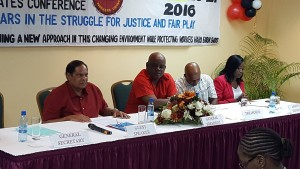 Prime Minister Moses Nagamootoo (left) and President of the Clerical and Commercial Workers Union, Sherwood Clarke next to him at the opening of the union's 4th Triennial Delegates Conference.