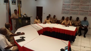 Police Commissioner David Ramnarine at lectern addressing a news conference. Also in picture are other senior police officers