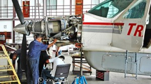 Aviation Technicians at work at the Caribbean Aviation Maintenance Services, a member of the Correia Group of Companies. (CAMS website photo).