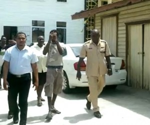 Robbery accused, Shemroy Hackett leaving the Vigilance Magistrates' Court after he was arraigned for several robbery and related offences.