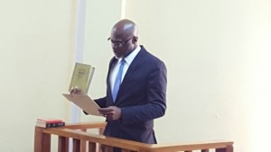 Retired Rear Admiral, Gary Best taking the oath of Commissioner to inquire into a mining death at Puruni, Region Seven.