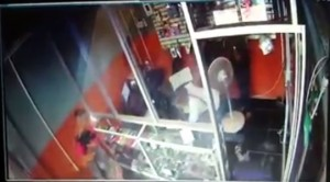 Bandits grab cell phones from a showcase at Celltopia store.