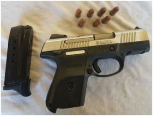 "The gun and ammunition that were allegedly found in possession of Eon ""Killa"" Warde at his home at Central Amelia's Warde, Linden."
