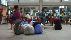 These Cuban women are seen at the Cheddi Jagan International Airport with a large quantity of items she purchased from stores in Georgetown.
