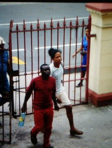 Troy Van Doimen (in red) entering the Georgetown Magistrates Court yard.