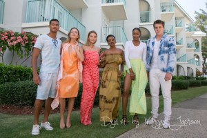 Models wearing the line of clothing made from Sunrise Center fabric design material.