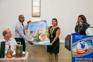GF's Managing Director, Anthony Autar, handing over a thank you gift to the President of the Rotary Club of Grand Cayman, Katherine Tathum.