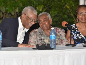 President David Granger and Ms. Carmen Jarvis share a light moment at the event at the Georgetown Club.