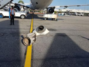 The damaged Fly Jamaica plane. Its ripped off tail cone is on the ground.